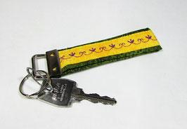 Schlüsselband grün gelb mit lila Stickerei