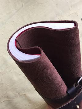 gerolltes Notizbuch