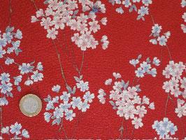 STOFF Kirschblütenzweige auf rotem strukturiertem Stoff