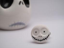 Tête macabre souriante