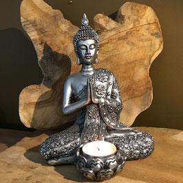 Bouddha statue avec bougeoir argenté