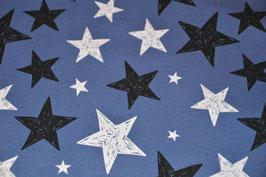 Weiße und schwarze Sterne auf Jeansblau