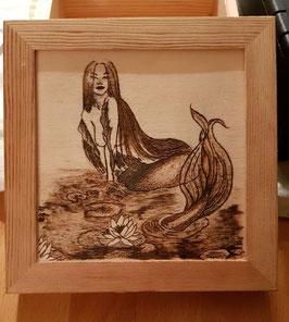 Meerjungfrau auf Aufbewahrungskiste