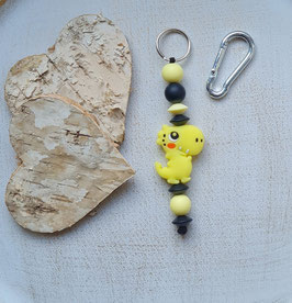 Taschen Anhänger Dino gelb/schwarz