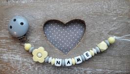 Nuggiketteli  Blume grau/pastelgelb