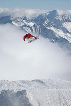 Glasbild Snowboard Big Air