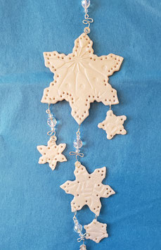 Glittery iridescent snowflakes decorate this lovely wintery Sun Catcher!