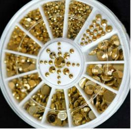 Gouden steentjes in verschillende maten