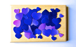 Petit puzzle coeurs bleus