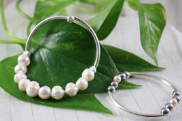 P 102.- Pulsera de plata de ley 925 con perlas y hematíte.
