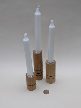 186.Trio of elegant turned candlesticks.