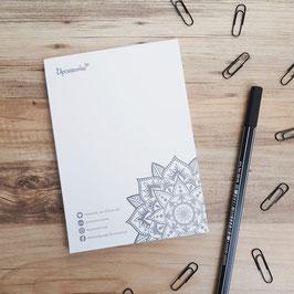 Postkarten und Notizblöcke