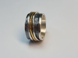 Ring geschwärzt mit 2 gelben und 2 weißen Drehringen