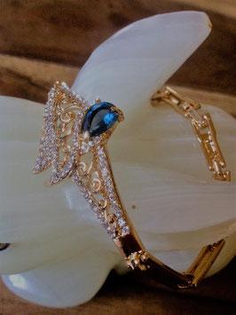 Bracelet plaqué or semi rigide, avec zircones brillants bleus
