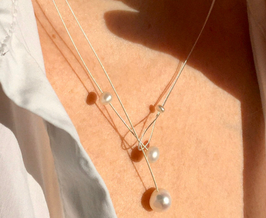 Small Freshwater pearl necklace. Classic pearls on a wire of silver.