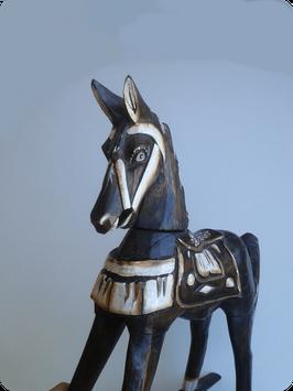 Statuette de cheval à bascule