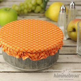 gelbes Muster auf orange – Abdeckhaube