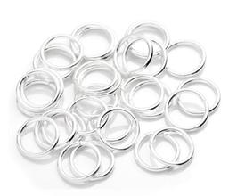 50 anneaux ouverts en métal argenté - 7 mm