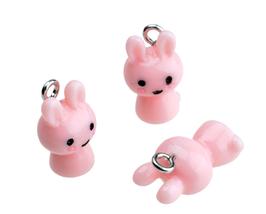 Breloque lapin en résine rose  3D -  17 x 10 mm -