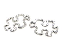 2 Connecteurs puzzle en métal argenté 30 x 18 mm - TR002