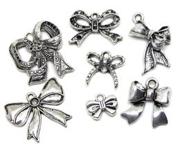 7 Breloques Noeuds mixtes en métal argenté -   RZZ37