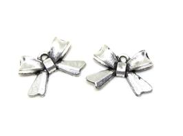 2 Breloques noeuds en métal argenté - 10 x 14 mm - RZZ181