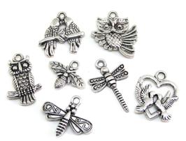 7 breloques animaux volants en métal argenté - RZZ8