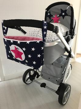 11/ Kinderwagentasche schwarz pink