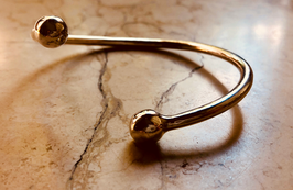BANGLE IN SOLID GOLD 18K WITH ANATOMICAL SPHERES