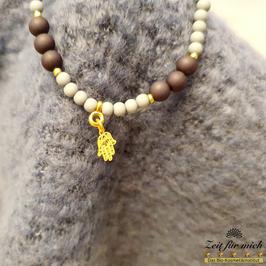 Armband mit goldener Buddhas Hand