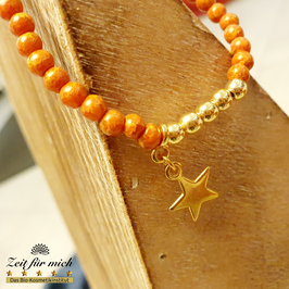 Armband mit goldfarbenem Sternanhänger
