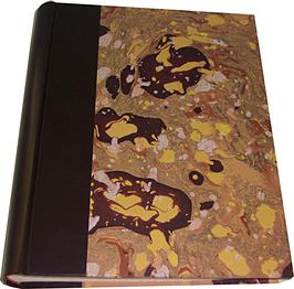 Album foto in pelle marrone e carta marmorizzata