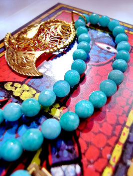Indian, handcrafted, gold-dipped, sterling-silver, mango-leaf pendant on necklace of aqua-blue amazonite beads.