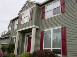 Bethesda - Powerwashing of vinyl siding and shutters. Painting of exterior trim, windows, doors and garage door.