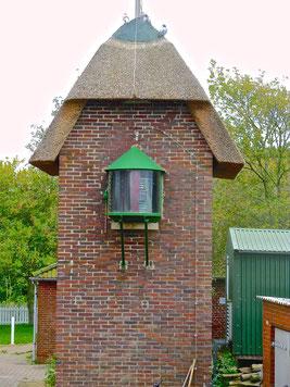 Reetgedeckter Leuchtturm