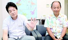 会見を開いた山城支店長(左)と伊志嶺課長=26日、同支店