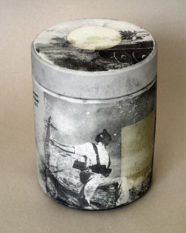 a series of symbolic funeral urns bearing images from famous war photographers