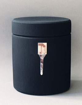 a large black funeral urn bearing an image from 9/11