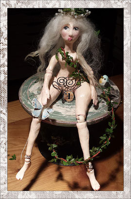 female ball jointed polymer clay doll with long gray hair, still undressed- work in progress