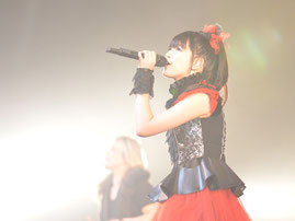 Photos of Suzuka performing with JAM Project