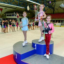 kunstschaatswedstrijd podium voor HSK