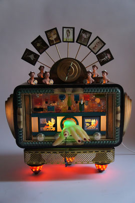 Kinetic sculpture,  radio box,  perfume bottles,  hand colored erotic photos