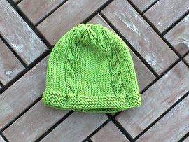 The Little Hipster Beanie - a green beanie with simple cable details, matching the cardigan