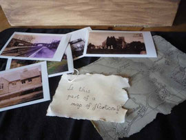 A map and old photos in the Treasures box