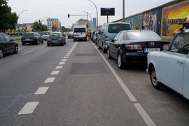 Sometimes the bicycle lanes are abused by cars (here at the East Side Gallery)