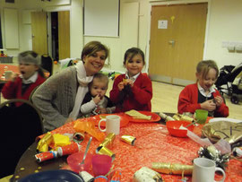 Parents and children enjoying a xmas breakfast together