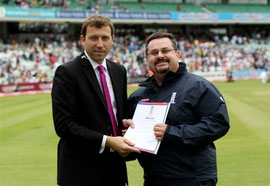 Ivo Favotto receives the 2010 ECB Europe Sky Sports Outstanding Coach Award from Mike Atherton
