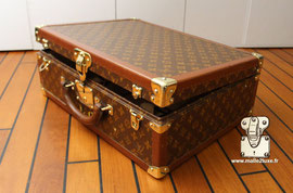 Loziné suitcase:  Rigid series with sockets (or protective strips) on the edges. Corners, buckles, safety lock with strictly personal number. Leather handle. Loziné means with  studded lozine borders  .    Model: Alzer, Bisten, Cotteville, Diplomat, Presi