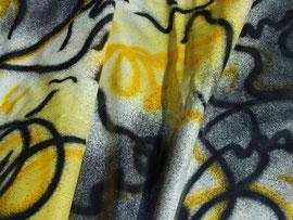 Graffiti-Wachstuch in gelb-schwarz