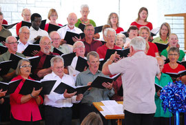 Tony Hogg conducting the Edgecumbe Choir in the 2103 'Christmas Joy' concert